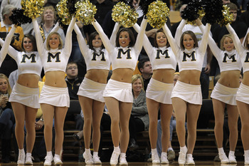 COLUMBIA, MO - DECEMBER 08:  Missouri Tiger cheerleaders in action during the game between the Vanderbilt Commodores and the Missouri Tigers on December 8, 2010 at Mizzou Arena in Columbia, Missouri.  (Photo by Jamie Squire/Getty Images)