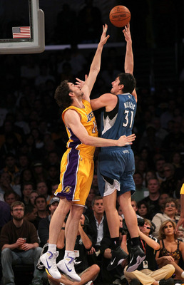 LOS ANGELES - NOVEMBER 9:  Darko Milicic #31 of the Minnesota Timberwolves shoots over Pau Gasol #16 of the Los Angeles Lakers at Staples Center on November 9, 2010 in Los Angeles, California.   NOTE TO USER: User expressly acknowledges and agrees that, b