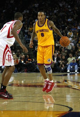 OAKLAND, CA - DECEMBER 03:  Monta Ellis #8 of the Golden State Warriors in action against the Houston Rockets during an NBA game at Oracle Arena on December 3, 2009 in Oakland, California. NOTE TO USER: User expressly acknowledges and agrees that, by down