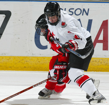 LONDON,ON - JANUARY 3:  Carter Ashton #9 of Team Ontario tries to muscle his way past Ryan Ellis #3 of Team Ontario in a game on January 3, 2008 at the John Labatt Centre in London, Ontario. Team Ontario defeated Team West 4-3 to earn a spot in the gold m