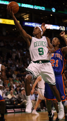BOSTON - NOVEMBER 18:  Rajon Rondo #9 of the Boston Celtics drives for the net past Wilson Chandler #21 of the New York Knicks on November 18,  2008 at TD Banknorth Garden in Boston, Massachusetts. NOTE TO USER: User expressly acknowledges and agrees that