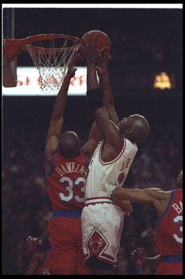 1 Nov 1991:  Guard Michael Jordan of the Chicago Bulls (right) goes up for two during a game against the Philadelphia 76ers at the United Center in Chicago, Illinois.  The Bulls won the game, 110-90. Mandatory Credit: Jonathan Daniel  /Allsport
