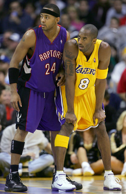 LOS ANGELES - DECEMBER 28:  Morris Peterson #24 of the Toronto Raptors lines up with Kobe Bryant #8 of the Los Angeles Lakers during the game on December 28, 2004 at Staples Center in Los Angeles, California.  The Lakers defeated the Raptors 117-99.  NOTE
