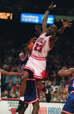 CHICAGO BULLS GUARD MICHAEL JORDAN LEAPS UP TO DEFEND AN INBOUNDS PASS DURING THEIR 103-83 EASTERN CONFERENCE FINAL WIN OVER THE NEW YORK KNICKS AT CHICAGO STADIUM IN CHICAGO, ILLINOIS.