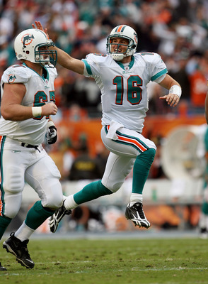 MIAMI - JANUARY 03:  Quarterback Tyler Thigpen #16 of the Miami Dolphins slaps the head of offensive lineman Joe Berger #67 to celebrate his touchdown pass to Davone Bess #15 against the Pittsburgh Steelers at Land Shark Stadium on January 3, 2010 in Miam