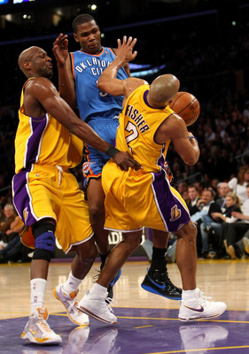LOS ANGELES, CA - FEBRUARY 10:  Kevin Durant #35 of the Oklahoma City Thunder picks up a charging foul as he runs into Derek Fisher #2 and Lamar Odom #7 of the Los Angeles Lakers on February 10, 2009 at Staples Center in Los Angeles, California.  The Lake
