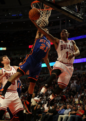 CHICAGO - NOVEMBER 04: Derrick Rose #1 of the Chicago Bulls puts up a shot against Wilson Chandler #21 of the New York Knicks at the United Center on November 4, 2010 in Chicago, Illinois. The Knicks defeated the Bulls 120-112. NOTE TO USER: User expressl