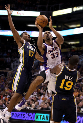 PHOENIX - OCTOBER 12:  Grant Hill #33 of the Phoenix Suns attempts a shot under pressure from Ronnie Price #17 and Raja Bell #19 of the Utah Jazz during the preseason NBA game at US Airways Center on October 12, 2010 in Phoenix, Arizona. NOTE TO USER: Use