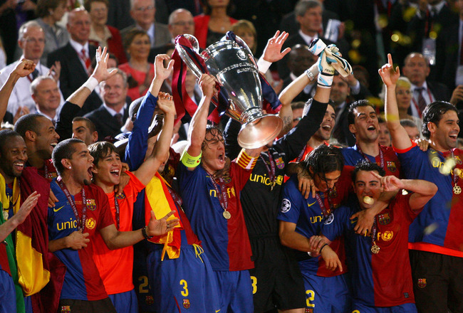 ROME - MAY 27:  Carles Puyol of Barcelona lifts the trophy as he and his team mates celebrates winning the UEFA Champions League Final match between Barcelona and Manchester United at the Stadio Olimpico on May 27, 2009 in Rome, Italy. Barcelona won 2-0.