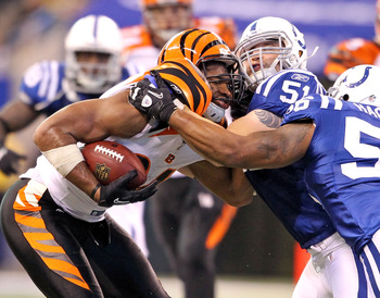 INDIANAPOLIS - NOVEMBER 14:  Jermaine Gresham #84 of the Cincinnati Bengals runs with the ball after catching and is tackled by Pat Angerer #51 of the Indianapolis Colts in the NFL game at Lucas Oil Stadium on November 14, 2010 in Indianapolis, Indiana.