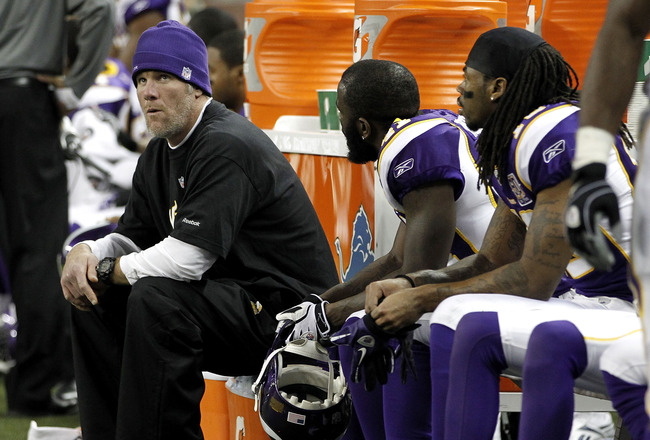 DETROIT, MI - DECEMBER 13:  Brett Favre #4 of the Minnesota Vikings looks on from the bench while playing the New York Giants at Ford Field on December 13, 2010 in Detroit, Michigan. New York won the game 21-3.  (Photo by Gregory Shamus/Getty Images)