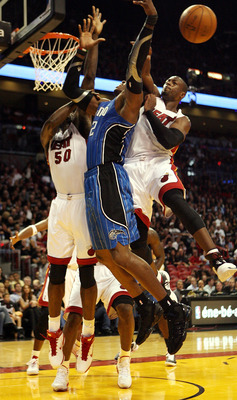 MIAMI - OCTOBER 29:  Guard Dwyane Wade #3 of the Miami Heat blocks a shot against Dwight Howard #12  of the Orlando Magic at American Airlines Arena on October 29, 2010 in Miami, Florida. NOTE TO USER: User expressly acknowledges and agrees that, by downl