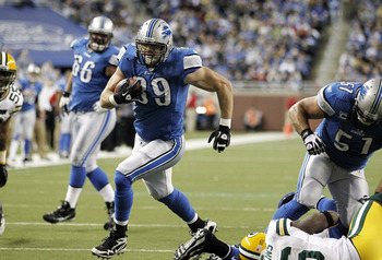 DETROIT, MI - DECEMBER 12:  Will Heller #89 of the Detroit Lions gets gets around Nick Collins #36 of the Green Bay Packers for a fourth quarter touchdown on December 12, 2010 at Ford Field in Detroit, Michigan. Detroit won the game 7-3 (Photo by Gregory