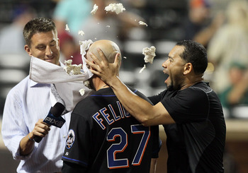 NEW YORK - JULY 31:  Jesus Feliciano #27 of the New York Mets gets a shaving cream pie in the face in celebration from teammate Pedro Feliciano #25 after scoring the winning run against the Arizona Diamondbacks in the ninth inning on July 31, 2010 at Citi