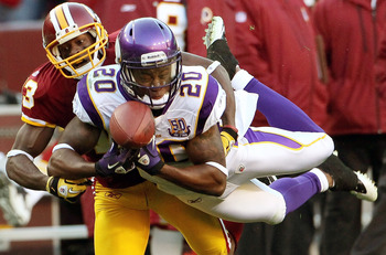 LANDOVER, MD - NOVEMBER 28: Safety Madieu Williams #20 of the Minnesota Vikings breaks up a pass intended for Anthony Armstrong #13 of the Washington Redskins at FedExField November 28, 2010 in Landover, Maryland. The Vikings won the game 17-13.  (Photo b