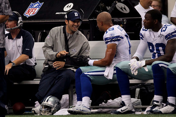 ARLINGTON, TX - OCTOBER 31:  Injured quarterback Tony Romo of the Dallas Cowboys talks with Miles Austin #19 against the Jacksonville Jaguars at Cowboys Stadium on October 31, 2010 in Arlington, Texas.  (Photo by Stephen Dunn/Getty Images)