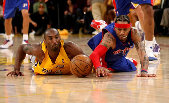 LOS ANGELES, CA - NOVEMBER 14: Kobe Bryant #24 of the Los Angeles Lakers and Allen Iverson #1 of the Detroit Pistons dive for a loose ball on November 14, 2008 at Staples Center in Los Angeles, California. The Pistons won 106-95.   NOTE TO USER: User expr