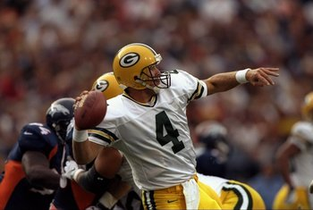 24 Aug 1998:  Quarterback Brett Favre #4 of the Green Bay Packers in action during the pre-season game against the Denver Broncos at the Mile High Stadium in Denver, Colorado. The Broncos defeated the Packers 34-31. Mandatory Credit: Brian Bahr  /Allsport