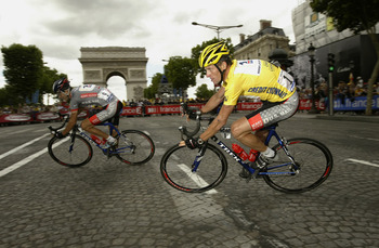 PARIS - JULY 27:  Lance Armstrong of the United States and riding for US Postal-Berry Floor passes the Arch de Triumphe behind teammate Jose Luis Rubiera during stage 20 of the Tour de France from Ville d'Avary to the Champs-Elysees on July 27, 2003 in Pa