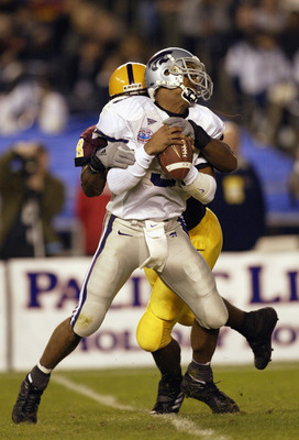 SAN DIEGO - DECEMBER 27:  Quarterback Ell Roberson #3 of the Kansas State Wildcats gets sacked by Terrell Suggs #48 of the Arizona Sun Devils during the first quarter of the Pacific Life Holiday Bowl at Qualcomm Stadium on December 27, 2002 in San Diego,