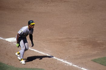ANAHEIM, CA - SEPTEMBER 6:  Rickey Henderson #24 of the Oakland Athletics leads off from third base during their MLB game against the California Angels at Anaheim Stadium on September 6, 1992 in Anaheim, California. (Photo by Ken Levine/Getty Images)