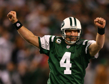 EAST RUTHERFORD, NJ - DECEMBER 28: Brett Favre #4 of The New York Jets celebrates after throwing a touchdown to Laveranues Coles #87 against The Miami Dolphins during their game on December 28, 2008 at Giants Stadium in East Rutherford, New Jersey. (Photo