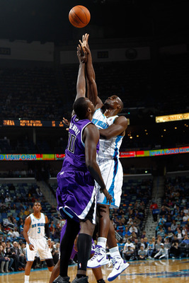 NEW ORLEANS, LA - DECEMBER 15:  Emeka Okafor #50 of the New Orleans Hornets shoots the ball over Samuel Dalembert #10 of the Sacramento Kings at the New Orleans Arena on December 15, 2010 in New Orleans, Louisiana.  NOTE TO USER: User expressly acknowledg