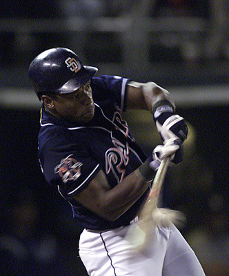 2 Oct 2001: Rickey Henderson #24 of the San Diego Padres connects with the ball during his team's game against the Los Angeles Dodgers at Qualcomm Stadium in San Diego, California.  DIGITAL IMAGE. Mandatory Credit: Donald Miralle/ALLSPORT