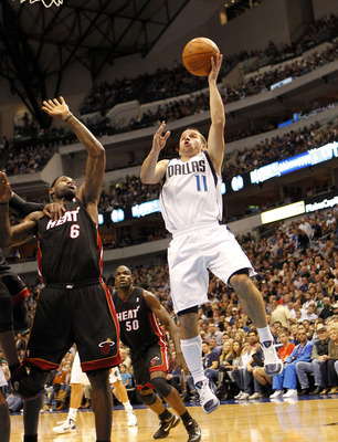 DALLAS - NOVEMBER 27: Jose Barea #11 of the Dallas Mavericks shoots over Lebron James #6 of the Miami Heat on November 27, 2010 at the American Airlines Center in Dallas, Texas. NOTE TO USER: User expressly acknowledges and agrees that, by downloading and