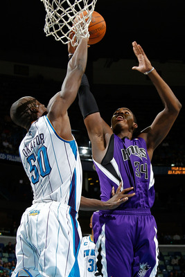 NEW ORLEANS, LA - DECEMBER 15:  Jason Thompson #34 of the Sacramento Kings shoots the ball over Emeka Okafor #50 of the New Orleans Hornets  at the New Orleans Arena on December 15, 2010 in New Orleans, Louisiana.  The Hornets defeated the Kings 94-91.  N
