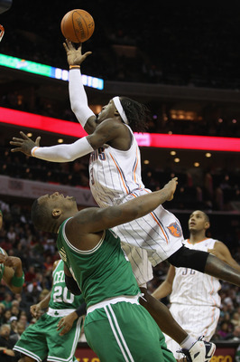 CHARLOTTE, NC - DECEMBER 11:  Glen Davis #11 of the Boston Celtics tries to stop Gerald Wallace #3 of the Charlotte Bobcats during their game at Time Warner Cable Arena on December 11, 2010 in Charlotte, North Carolina. NOTE TO USER: User expressly acknow