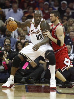 CLEVELAND - APRIL 17:  Shaquille O'Neal #18 of the Cleveland Cavaliers tries to get around the defense of Brad Miller #52 of the Chicago Bulls in Game One of the Eastern Conference Quarterfinals during the 2010 NBA Playoffs at Quicken Loans Arena on April