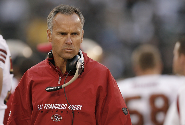 OAKLAND, CA - AUGUST 08:  Head coach Mike Nolan of the San Francisco 49ers scowls on the sidelines during a preseason game against the Oakland Raiders on August 8, 2008, at the McAfee Coliseum in Oakland, California.  (Photo by Greg Trott/Getty Images)