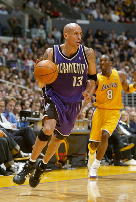 LOS ANGELES - FEBRUARY 26:  Doug Christie #13 of the Sacramento Kings drives during the game against the Los Angeles Lakers at Staples Center on February 26, 2004 in Los Angeles, California.  The Kings won 103-101.  NOTE TO USER: User expressly acknowledg