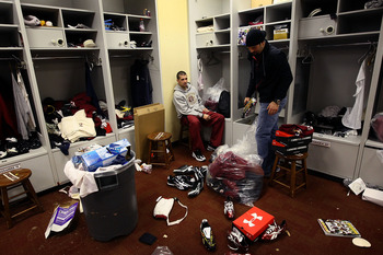 ASHBURN, VA - JANUARY 04:  Washington Redskins kicker Graham Gano (L) and punter Hunter Smith (R) clean out their lockers before a press conference by Redskins General Manager Bruce Allen on the dismissal of Head Coach Jim Zorn at Redskins Park January 4,