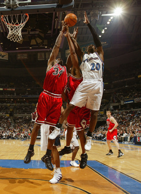 WAHINGTON - MAY 2:  Antonio Davis #34 of the Chicago Bulls rebounds against Larry Hughes #20 of the Washington Wizards in Game four of the Eastern Conference Quarterfinals during 2005 NBA Playoffs on May 2, 2005 at the MCI Center in Washington D.C. The Wi