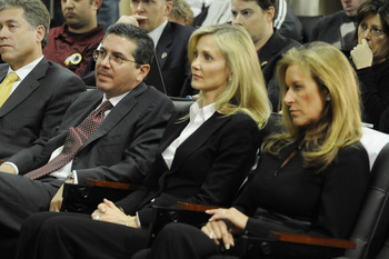 ASHBURN,VA - JANUARY 6:  Dan Snyder (L), owner of the Washington Redskins with wife Tanya (C) and Peggy Shanahan (R) look on as Mike Shanahan is introduced to the media on January 6, 2010 at Redskins Park in Ashburn, Virginia.  (Photo by Mitchell Layton/G