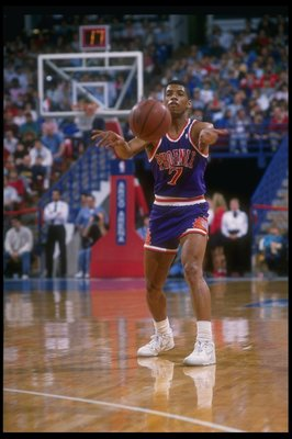 1988-1989:  Guard Kevin Johnson of the Phoenix Suns moves the ball during a game. Mandatory Credit: Otto Greule  /Allsport Mandatory Credit: Otto Greule  /Allsport