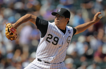 DENVER - SEPTEMBER 15:  Starting pitcher Jorge De La Rosa #29 of the Colorado Rockies delivers against the San Diego Padres at Coors Field on September 15, 2010 in Denver, Colorado.  (Photo by Doug Pensinger/Getty Images)
