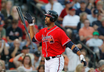 ATLANTA - OCTOBER 10:  Derrek Lee #27 of the Atlanta Braves reacts after striking out against the San Francisco Giants during Game Three of the NLDS of the 2010 MLB Playoffs at Turner Field on October 10, 2010 in Atlanta, Georgia.  (Photo by Kevin C. Cox/