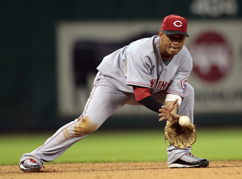 HOUSTON - JULY 24:  Shortstop Orlando Cabrera #2 of the Cincinnati Reds makes a play on a ball hit in the hole against the Houston Astros at Minute Maid Park on July 24, 2010 in Houston, Texas.  (Photo by Bob Levey/Getty Images)