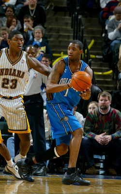 INDIANAPOLIS - DECEMBER 17:  Tracy McGrady #1 of the Orlando Magic looks to pass as he is covered by Ron Artest #23 of the Indiana Pacers on December 17, 2003 at Conseco Fieldhouse in Indianapolis, Indiana.  The Magic won 94-90.  NOTE TO USER: User expres
