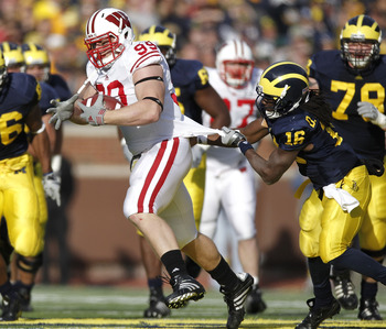 ANN ARBOR, MI - NOVEMBER 20:  J.J. Watt #99 of the Wisconsin Badgers is tackled after intercepting a fourth quarter pass by Denard Robinson #16 of the Michigan Wolverines at Michigan Stadium on November 20, 2010 in Ann Arbor, Michigan. Wisconson won the g