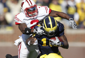 ANN ARBOR, MI - NOVEMBER 20:  Jay Valai #2 of the Wisconsin Badgers tackles Denard Robinson #16 of the Michigan Wolverines at Michigan Stadium on November 20, 2010 in Ann Arbor, Michigan.  (Photo by Gregory Shamus/Getty Images)