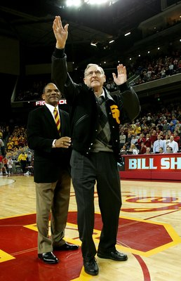 LOS ANGELES - JANUARY 13:  Former USC basketball player and  Basketball Hall of Fame NBA player and coach Bill Sharman (R) waves to the crowd after being presented with a USC letter jacket by USC Trojans athletic director Mike Garrett during ceremonies to
