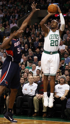 BOSTON, MA - DECEMBER 16:  Ray Allen #20 of the Boston Celtics takes a shot as Jason Collins #34 of the Atlanta Hawks on December 16, 2010 at the TD Garden in Boston, Massachusetts. NOTE TO USER: User expressly acknowledges and agrees that, by downloading