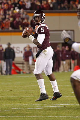 BLACKSBURG, VA - NOVEMBER 04:  Quarterback Tyrod Taylor #5 of the Virginia Tech Hokies prepares to throw the ball against the Georgia Tech Yellow Jackets at Lane Stadium on November 4, 2010 in Blacksburg, Virginia.  (Photo by Geoff Burke/Getty Images)
