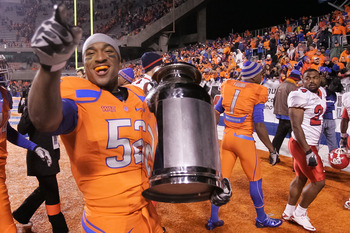 BOISE, ID - NOVEMBER 19:  Derrell Acrey #52 of the Boise State Broncos carries the Milk Can, which is the Boise State - Fresno State rivalry trophy, after the win against the Fresno State Bulldogs at Bronco Stadium on November 19, 2010 in Boise, Idaho.  (