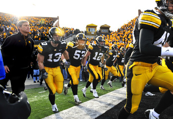 IOWA CITY, IA - NOVEMBER 20:  University of Iowa Hawkeyes head coach Kirk Ferentz takes the field with his team for the Ohio State Buckeyes NCAA college football game at Kinnick Stadium on November 20, 2010 in Iowa City, Iowa. Ohio State won 20-17 over Io