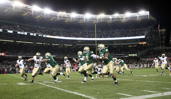 NEW YORK - NOVEMBER 20: Darrin Walls #2 of the Notre Dame Fighting Irish runs the ball in for a touchdown after an interception in the thrid quarter against the Army Black Knights at Yankee Stadium on November 20, 2010 in the Bronx borough of New York Cit